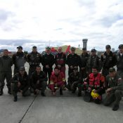 With the helicopter and ground crews and officials at the airport.
